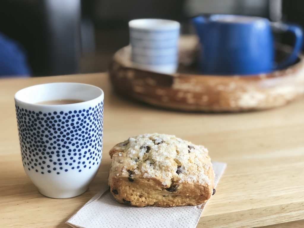 Black tea with a chocolate chip scone